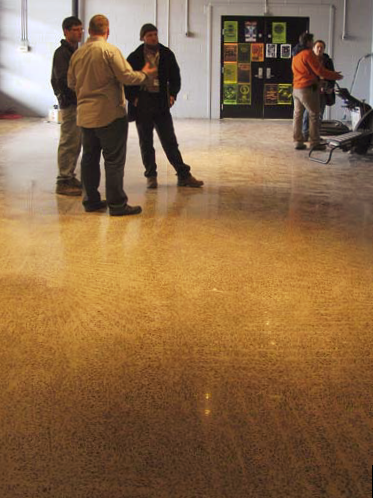 Show attendees standing on the freshly polished concrete floor.