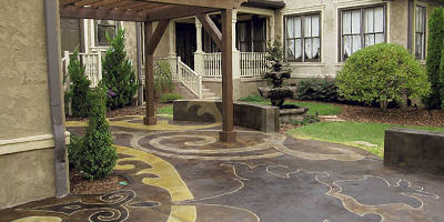 An outdoor patio with a design that has been stained and engraved.