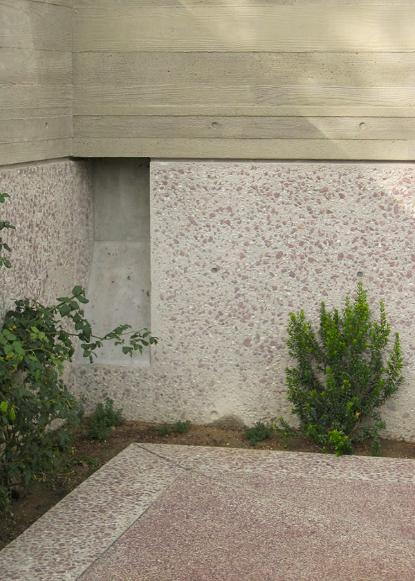 "Renovations to the J. Paul Getty Museum at the Getty Villa had to provide structural support and be aesthetiaclly pleasing at the same time. Here, the lower ""strata"" on a site retaining wall uses exposed decorative red aggregate. The horizontal slab contains the same red aggregate."