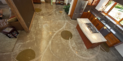 Concrete kitchen floor with circles and other decorative elements stained into it.