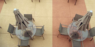 Patio furniture on a resurfaced pool deck.