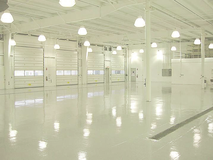 A completely white garage with white walls and a white floor.