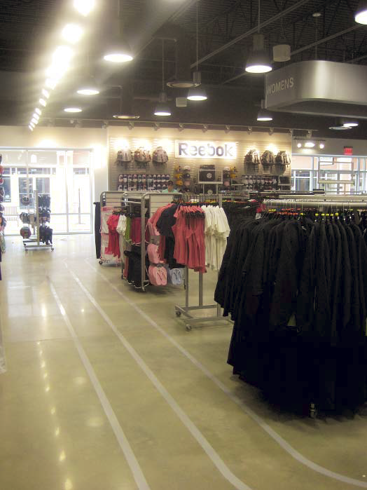 Lines that emulate a track in this retail space dedicated to sporting apparel.