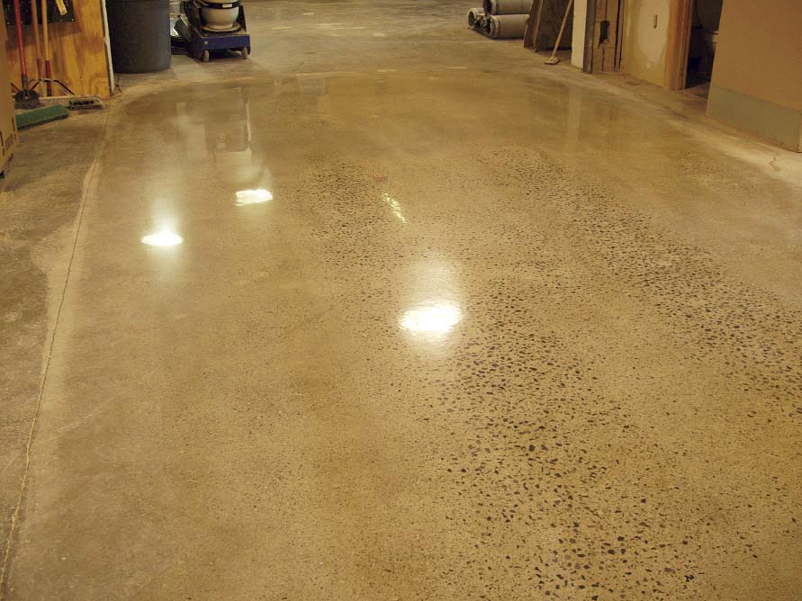 Polished concrete floor to expose the aggregate.