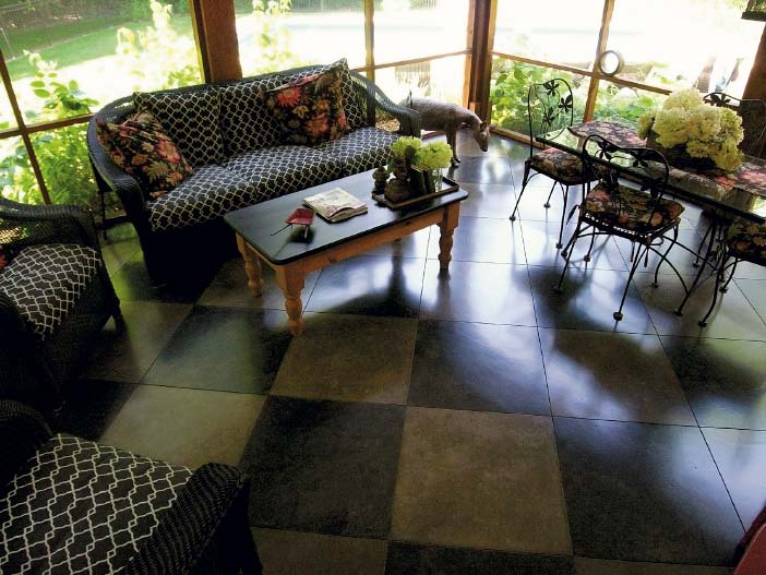 Living room floor of concrete in a checkerboard pattern.