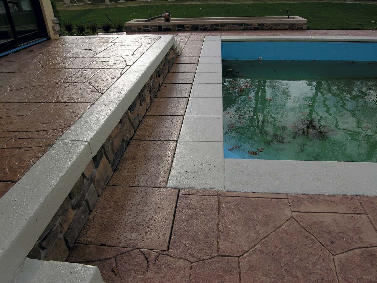 Poolside stamped concrete with multiple colors