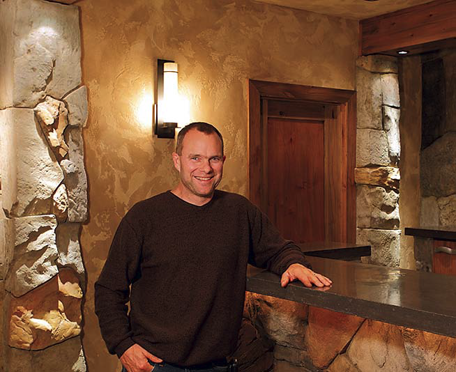 Troy Lemon of Cornerstone Decorative Concrete stands next to some of his decorative concrete work.