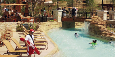 Lazy river at a Texas Resort winds its way around pool.