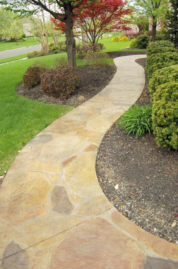 A pathway that has been stamped and stained to look like natural stone.