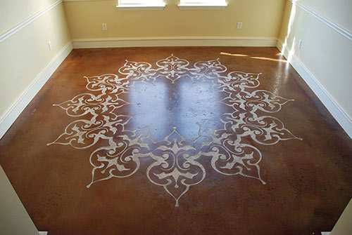 Stenciled, sand blasted and stained concrete in a dining room.