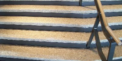 Stair steps made of two color variations of concrete.