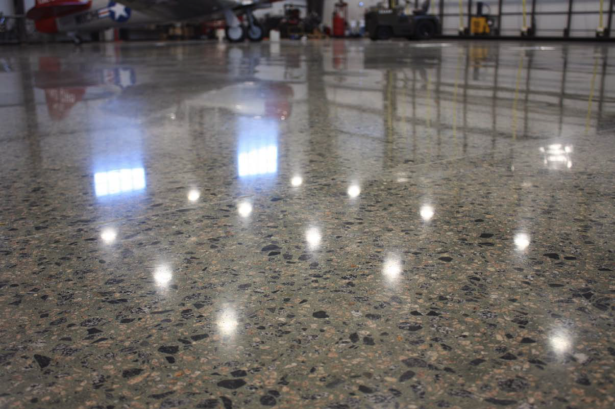 Integrally colored exposed aggregate and polished for Exposed concrete floor