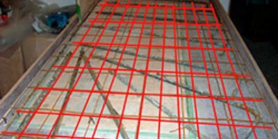 Orange fence type material used as concrete countertop reinforcement.