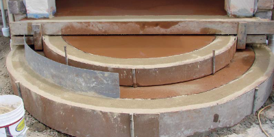 Formed half round concrete steps in terra cotta color