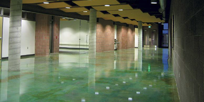 highly reflective teal green acid stained floor.