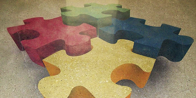A stencil in the shape of puzzle pieces was applied to this concrete floor and takes on a 3-D look.