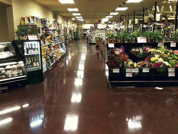 Grocery store with red polished concrete in the produce section.