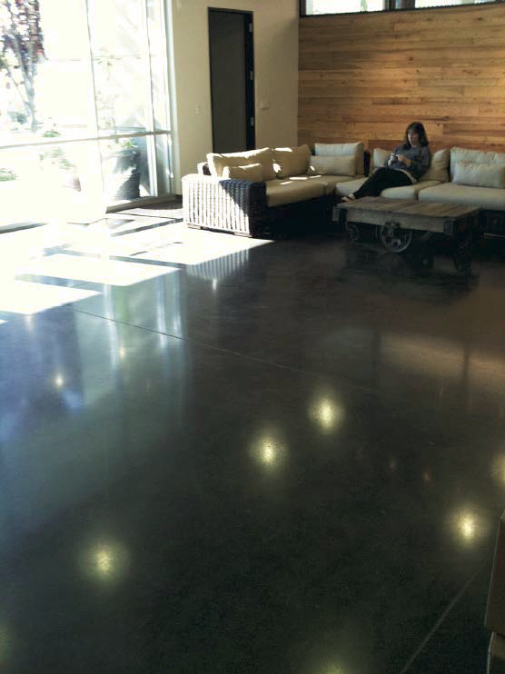 Polished concrete in a lounge area with a high gloss.