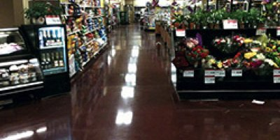 Polished concrete in a grocery store in a rich brown color by Adrian Henry, Diacon.