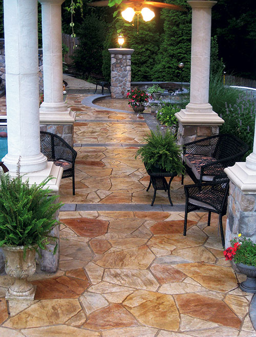 Greystone masonry created a tropical oasis in a South Caroline backyard using precast concrete stones.