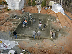 Workers installed 80 yards of shotcrete when constructing the pool prior to using stamped concrete to complete a Hidden Oasis by Greystone Masonry.