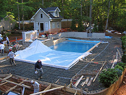 Crews had to cautiously work around more than a mile of plumbing and electric when pouring the pool deck.