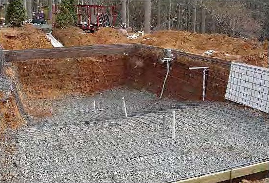 "More than 2 1/2 tones of 4-pound rebar were installed 12 inches on center for extra reinforcement in the new concrete pool at the ""Hidden Oasis."""