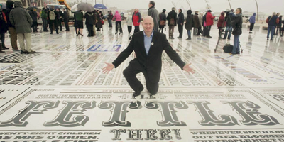 Graphic artist who created The Comedy Carpet poses with his final piece.