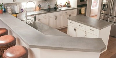 Concrete countertops in this kitchen.