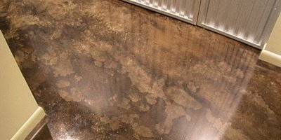 Stained concrete floor in a brown and lighter brown color.