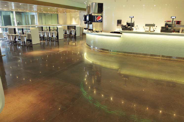 Polished and colored concrete in a food court is an easy to clean alternative for flooring in high-traffic areas.