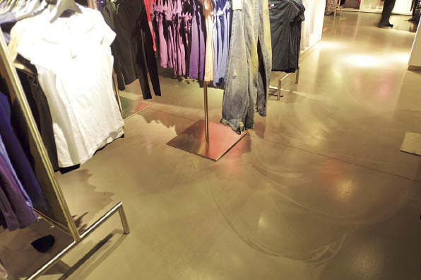 Retail space is completed with a stained concrete floor.