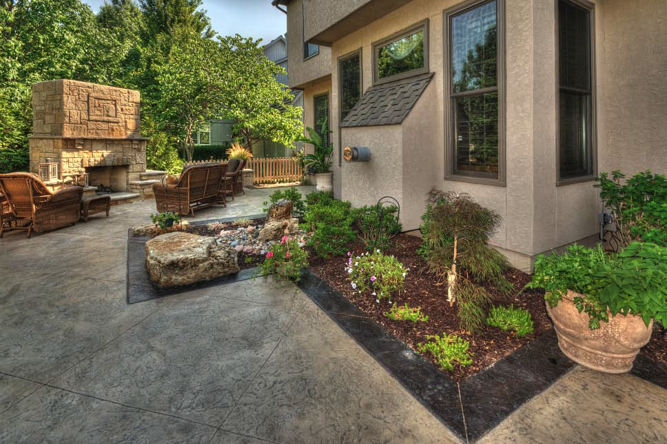 Artistic Concrete Surfaces, which added landscaping to its roster of services in 2009, used spruce and river birch trees combined with a natural stone riverbed to solve water runoff issues in the Bilovesky backyard.