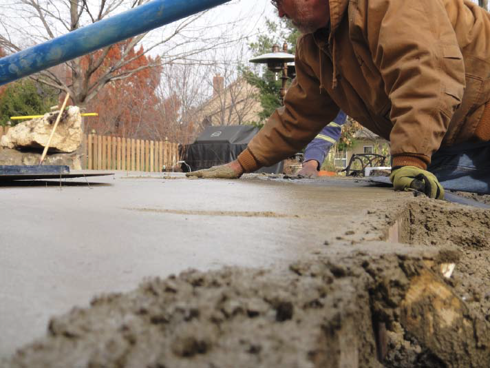To avoid burying or breaking the fiber optics when installing the concrete, the crew from Artistic Concrete Surfaces, Olathe, Kan., attached the fibers to nails with tie wire first. They then carefully placed and stamped concrete around the nails.