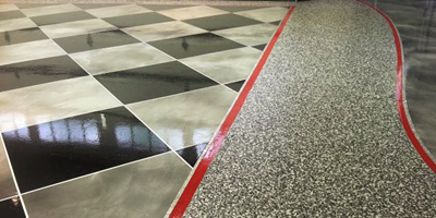 Garage floor coating that was achieved using metallic epoxy in a checkerboard pattern.