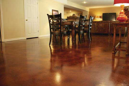 A look at a dining room with a stained concrete in reddish brown.