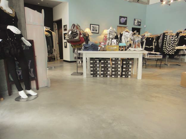 Retail space done with a light light gray concrete floor.
