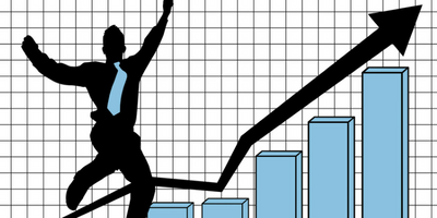 Man jumping on a graph with an upward arrow of improvement.
