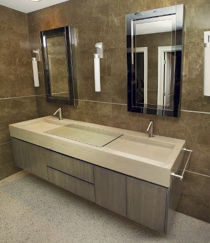 A high-end bathroom with a concrete countertop that has an invisible drain.