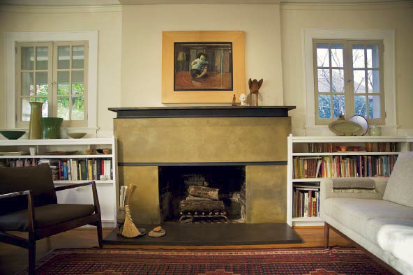 A concrete fireplace surround in a yellowish green color.