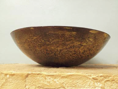 Bowl on a concrete countertop in a show room.