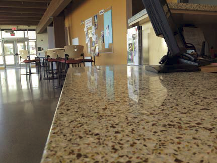 A close up of a concrete countertop in a kitchen space