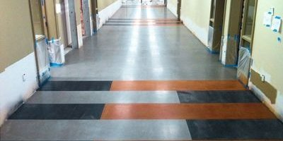 A high school in Yakima Washington with polished concrete floors in the hallway.