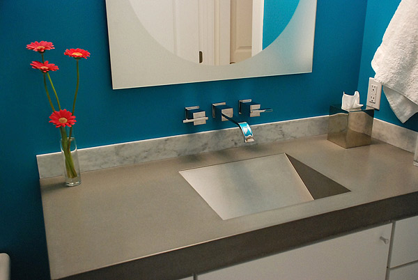 Dimensional sink shape in concrete countertop. The variety of sink shapes you can make with concrete blows away what can be done with granite and marble