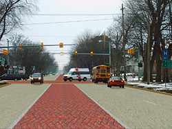 Roadway integrally colored and stamped in a herringbone brick pattern