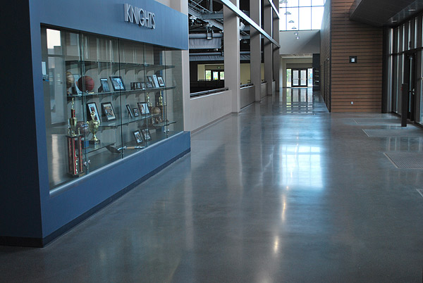 Densified concrete floor at high school in San Marcos - Spaces to be polished included common areas, corridors and most classrooms. Carpeting, sheet flooring and resinous flooring systems were used in a number of lab and non-classroom spaces.