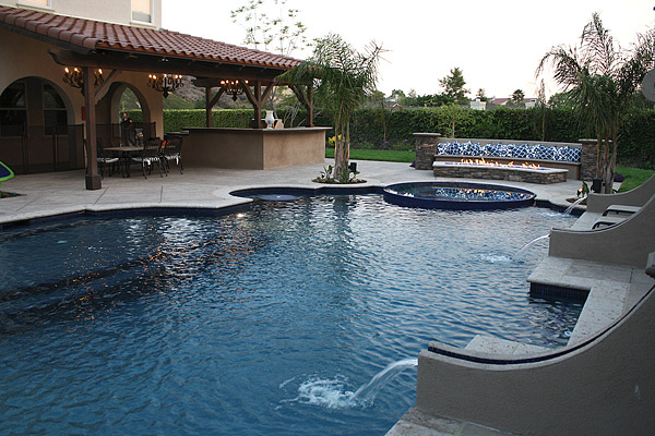 Concrete fire pit and swimming pool Photos courtesy of Green Scene Landscaping and Swimming Pools