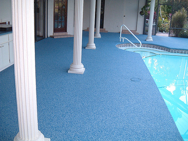 Florida homeowners opted to resurface a patched and repaired concrete pool deck with TPV rubber. Photo courtesy of American Recycling Center Inc.