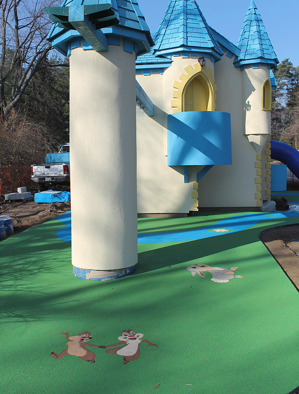 TPV rubber kids play area - One of the more whimsical projects John Schroeter, of Toronto, Ontario, has done involves a children's castle, complete with precast cartoon characters made from colorful TPV. The TPV floor inside looks like cobblestone. Photo courtesy of Ideal Surfacing