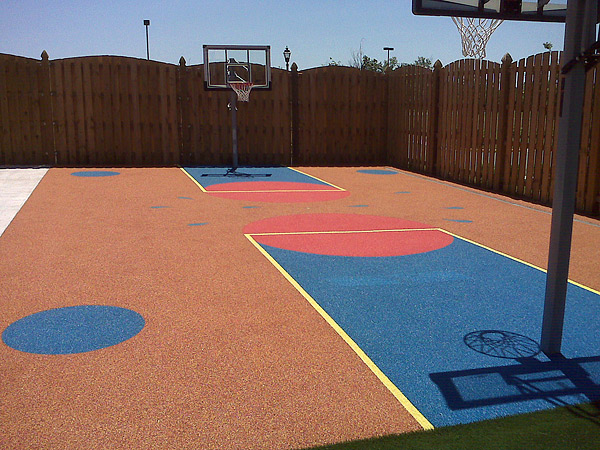 Designed for youngsters in a Virginia daycare facility, this flexible TPV-coated basketball court reduces the possibility of injuries from falls. Photo courtesy of American Recycling Center Inc.
